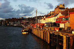 (C) Licensed to London News Pictures. 23/04/2016<br /> Whitby, UK<br /> <br /> Early morning sun shines down on the harbour in the North Yorkshire coastal town of Whitby. <br /> <br /> Photo Credit: Ian Forsyth/LNP