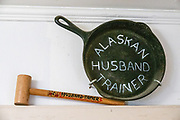 Alaskan husband trainer (cast-iron pan) and husband-tamer (wood mallet) hammers, at the Hammer Museum, in Haines, Alaska, USA