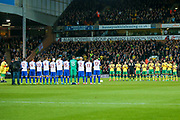Both sets of players have a minutes applause for Ugo Eiogu during the EFL Sky Bet Championship match between Norwich City and Brighton and Hove Albion at Carrow Road, Norwich, England on 21 April 2017. Photo by Simon Davies.
