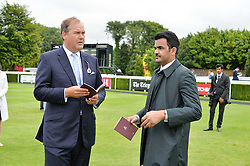 Let to right, the HON.HARRY HERBERT and SHEIKH JOAAN BIN HAMAD BIN KHALIFA AL-THANI of Qatar at day 3 of the Qatar Glorious Goodwood Festival at Goodwood Racecourse, Chechester, West Sussex on 28th July 2016.
