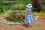Little girl enjoys a pond