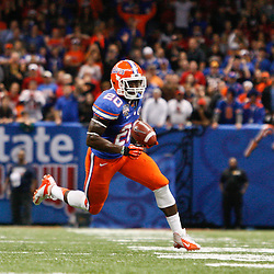 Jan 2, 2013; New Orleans, LA, USA; Florida Gators flanker Omarius Hines (20) runs with the ball against the Louisville Cardinals during the fourth quarter of the Sugar Bowl at the Mercedes-Benz Superdome. Louisville defeated Florida 33-23. Mandatory Credit: Derick E. Hingle-USA TODAY Sports