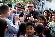 Darmstadt - Eberstadt | 20. April 2010..Coming home: Menowin Froehlich (2. Platz 7. Staffel Deutschland sucht den Superstar DSDS) zu Besuch in Darmstadt-Eberstadt, hier: Menowin ist von einer grossen Gruppe von Kindern und Jugendlichen umringt...©peter-juelich.com