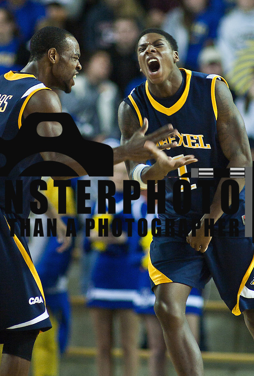 12/03/11 Newark DE: Drexel forward Kazembe Abif #1 (Right) celebrates after being fouled by Devon Saddler of Delaware while taking a shot attempt during a Colonial Athletic Association conference basketball game, Saturday, Dec. 03, 2011 at the Bob carpenter center in Newark Delaware...Sophomore Guard #10 Devon Saddler would finish the game with 30 total points, Delaware defeat Drexel 71-60.