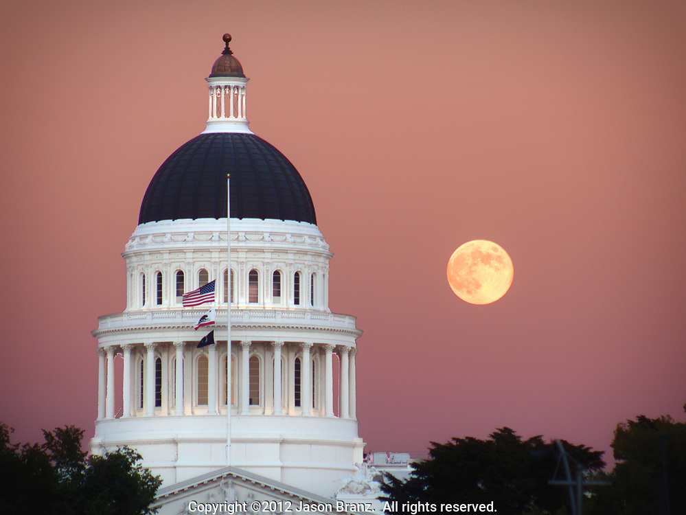 Full moon rising next to the California state capitol, Sacramento, California.