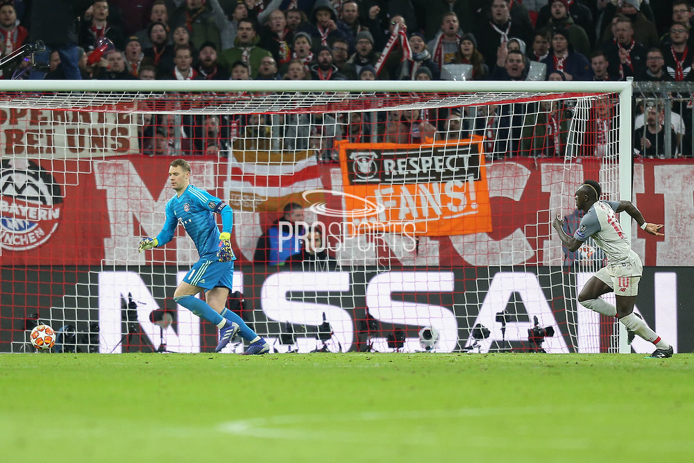 Liverpool forward Sadio Mane (10) spots an opportunity as Bayern Munich goalkeeper Manuel Neuer (1) takes his time to clear the ball during the Champions League match between Bayern Munich and Liverpool at the Allianz Arena, Munich, Germany, on 13 March 2019.