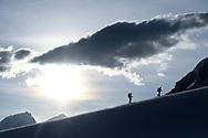 Two alpinists are ascending on the Zmuttgletscher, Valais, Switzerland