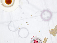 Table Cloth with Empty Cup and Glass and Moisture Rings