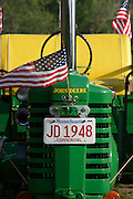 American flags mounted on a tractor and hayride wagon blow in the wind, Brewster (Cape Cod), Massachusetts.