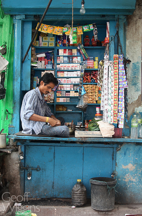 Shopkeeper at small shop in Kolkata the capital of the Indian state of West Bengal.