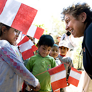 Secretary Donna Shalala, talks with children from Neque, during the CARE Learning Tours visit to their village. CARE is helping support community activities in Neque...Microfinance programs use a proven community based group savings and loans methodology as an entry point to mobilize group members to address a wide range of constraints to the social and economic empowerment of marginalized women and girls. ..Women in the community have said that when they first joined the group their husbands didn't take much notice. Now they are working with their husbands to discuss loans and business plans and ways to help their families. The group meets monthly and provides support to each other both financially and by sharing their experiences with their individual businesses. ..Increasing access to financial services for the poor must be part of an integrated and holistic approach to community empowerment in order to effectively address maternal health. Such an approach acknowledges the deep inequities that shape health seeking behaviors and would marry supply and demand by strengthening health systems and service delivery on the one hand while building community pressure for quality care on the other. ..