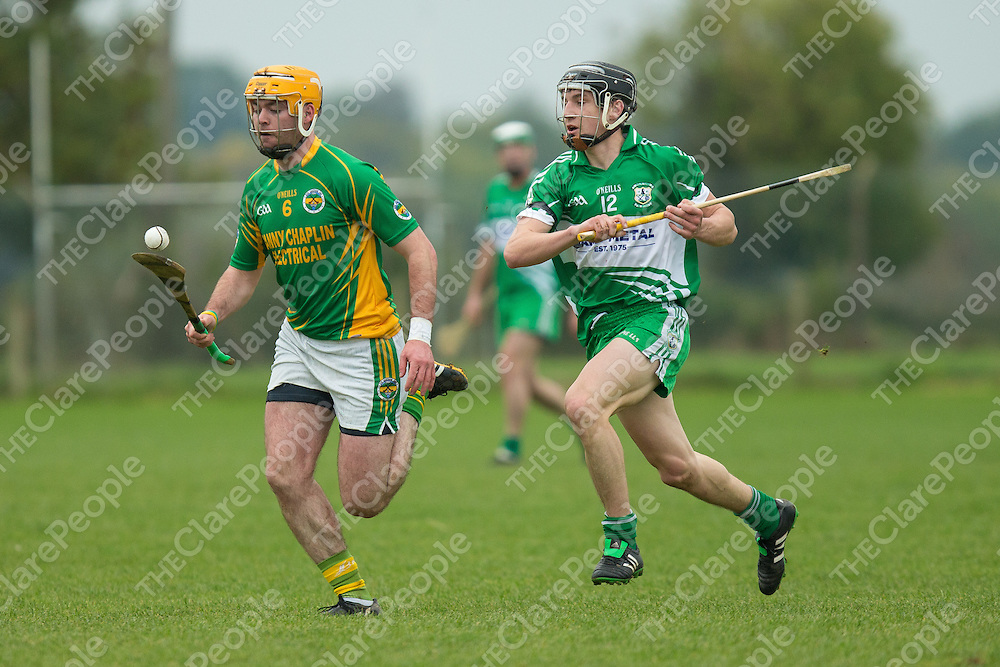 Broadford's Cathal Chaplin solos the ball away while hooped by Wolfe Tone's Rory Hayes