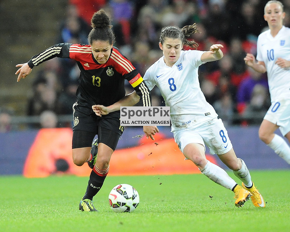 England's Karen Carney, battles with Germanys Celia Sasic, England v Germany Ladies, Breast Cancer Care International, Wembley , Sunday 23rd November 2014