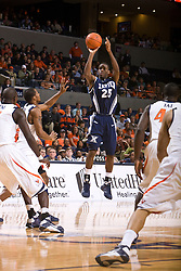 Xavier guard Dante Jackson (25) shoots a jump shot against UVA.  The #22 ranked Xavier Musketeers defeated the Virginia Cavaliers 84-70 at the John Paul Jones Arena on the Grounds of the University of Virginia in Charlottesville, VA on January 3, 2009.