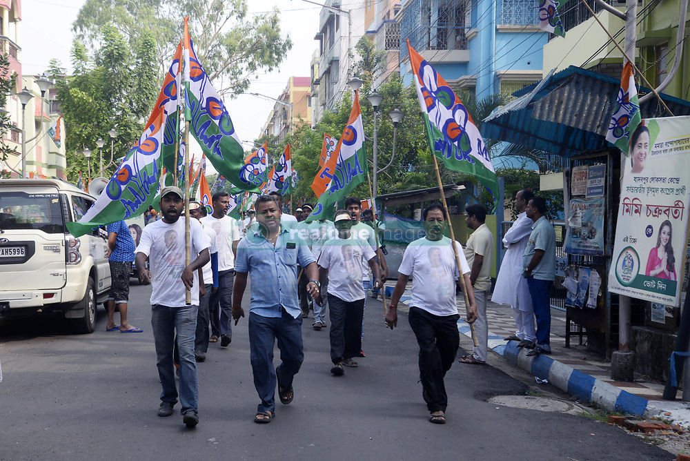 May 5, 2019 - Kolkata, West Bengal, India - Trinamool Congress or T.M.C. activist hold flag of their party during an election campaign of T.M.C. candidate for Jadavpur Lok Sabha Constituency, Mimi Chakraborty ahead of Lok Sabha poll. (Credit Image: © Saikat Paul/Pacific Press via ZUMA Wire)
