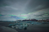 Northern lights in the sky over Jökulsárlón glacial lagoon, southeast Iceland.