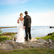 A Bride and Groom look over Long Island Sound from the Rocks of Southport, CT.