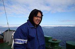 ATLANTIC OCEAN ABOARD ARCTIC SUNRISE 31MAY11 - Cook Willie Ferrer of the Philippines   aboard the Greenpeace Ship Arctic Sunrise in the Arctic sea ice in the Labrador Sea.....jre/Photo by Jiri Rezac / Greenpeace