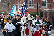 Middletown, New York - Members of St. Joseph's Church march through the city during the festival of Nuestra Senora de Guadalupe on Sunday, Dec. 9, 2012.