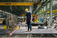 SANTA MARIA DEGLI ANGELI (ASSISI), ITALY - 11 JUNE 2018: A worker checks an oxy fuel cutting machine at the IRON S.p.A. factory, a publicly traded company that makes industrial steel parts, in Santa Maria degli Angeli (Assisi), Italy, on June 11th 2018.<br /> <br /> President Donald Trump's administration plans to impose tariffs on European steel and aluminum imports after failing to win concessions from the European Union, a move that could provoke retaliatory tariffs and inflame trans-Atlantic trade tensions. Until the moment that the American president rendered his decision, Mr. Capponi, the commercial director of IRON spa, was confident the continent would be spared.<br /> Given that IRON is a purchaser of steel, the company might benefit from the American tariffs. Steel now shipped to the United States from mills within Europe might stay here to avoid the tariffs, raising the supply and dropping prices. Chinese producers who export to American shores could divert their product to Europe, amplifying this trend.<br /> But Mr. Capponi was banking on none of this. Even if steel prices decline, his customers are likely to squeeze him for lower prices. More broadly, the American tariffs — justified by the Trump administration as a supposed defense of national security — reverberated as a blow against world trade.