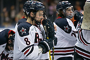 Robert Morris defenseman Eric Israel watches the awards ceremony after RIT defeated Robert Morris in the Atlantic Hockey final at the Blue Cross Arena in Rochester on Saturday, March 19, 2016.
