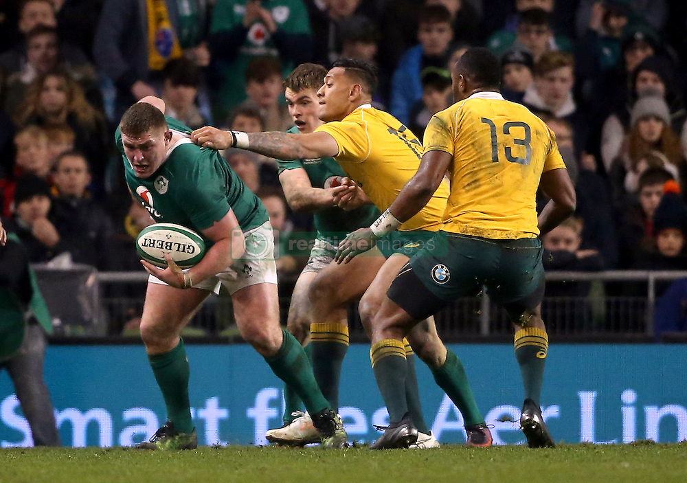 Ireland's Tadhg Furlong is held back by Australia's Israel Folau during the Autumn International match at the Aviva Stadium, Dublin.