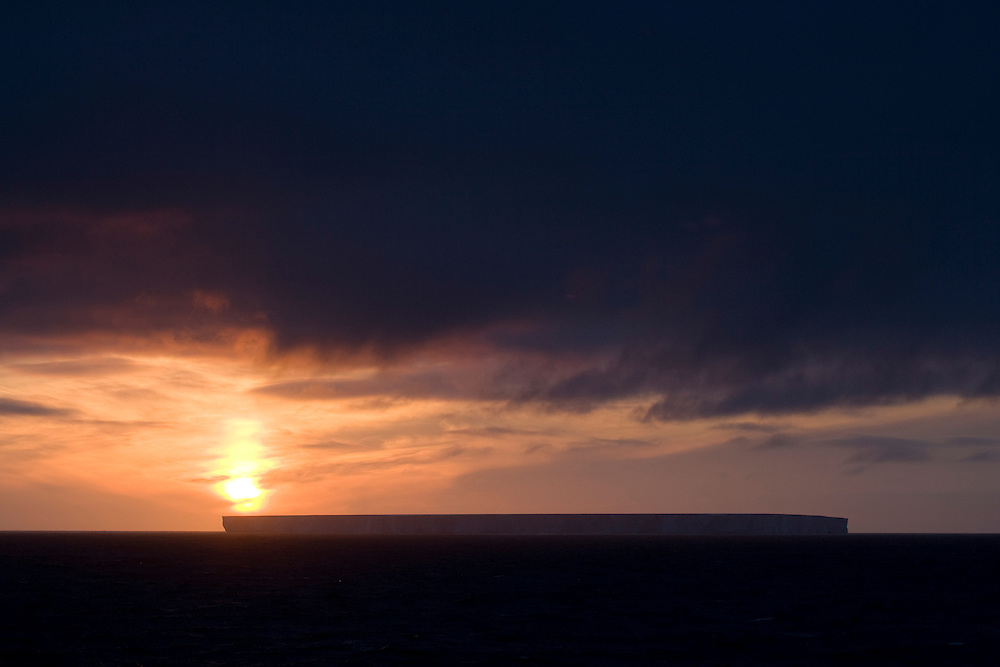 February 10th 2007. Southern Ocean. The sun sets behind in iceberg in the Ross Sea.