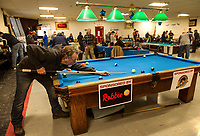 Jim Crampitz lines up his shot during the Robbie Mills 8-Ball Tournament at the Rod and Gun on Saturday afternoon.  (Karen Bobotas/for the Laconia Daily Sun)