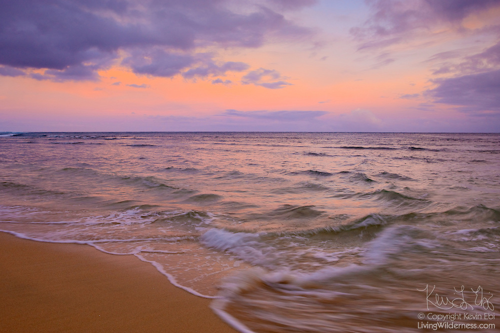Choppy waves strike Ke`E Beach during a stormy sunrise on the north coast of Kauai, Hawaii.