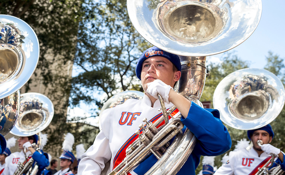 A member of the Gators Marching Band plays the sousaphone during the 2015 Homecoming Parade. (photo by Samuel Navarro)