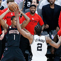 01 May 2017: San Antonio Spurs forward Kawhi Leonard (2) defends on Houston Rockets forward Trevor Ariza (1) during the Houston Rockets 126-99 victory over the San Antonio Spurs, in game 1 of the Western Conference Semi Finals, at the AT&T Center, San Antonio, Texas, USA.
