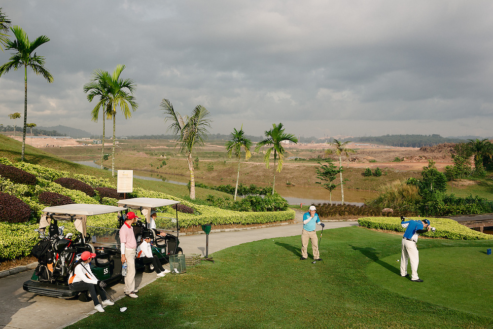 Golfers at the newly built Horizon Hills Golf Club. In the distance are building sites for new gated residential communities, a continuation of the Horizon Hills development. The area is part of the five flagship zones that have been undergoing massive changes in Iskandar region. Iskandar Malaysia (IM), formerly known as Iskandar Development Region (IDR) and South Johor Economic Region (SJER) is the main southern development corridor in Johor, Malaysia. The Iskandar Malaysia was established on 30 July 2006. The project is administered by Iskandar Regional Development Authority (IRDA) and was named after the late Sultan of Johor, Almarhum Sultan Iskandar. The economic growth plan of the CDP consists of two components, a Strategic Economic Thrust (SET) for immediate implementation and a Future Growth Scenario, 2005-2025, for long-term application. Both of these were developed in mind of the region's economic strengths in manufacturing and services, with 60% of value-added manufacturing derived from electrical and electronic (E&E), chemical and chemical products (petrochemical, plastics, oleo chemicals) and food processing sub-sectors. A number of service and other manufacturing areas have emerged in support of these. The SET focuses on such factors as strengthening existing economic sectors and encouraging diversity, through incentives, stronger international ties, and proper allocation of resources and space. The Future Growth Scenario is aimed towards strengthening the economy internally and internationally by such factors as improvements in global transportation and developing manufacturing and service clusters. Also promoted by the Future Growth Scenario is the encouragement of the immigration of skilled, monied foreigners to help develop an international lifestyle attractive to foreign workers and investors. The targeted foreign and local investments for the IM is US$ 100 billion.