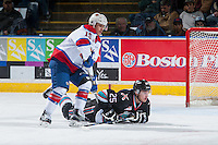 KELOWNA, CANADA - NOVEMBER 20: Andrew Koep #15 of Edmonton Oil Kings checks Cal Foote #25 of Kelowna Rockets to the ice during first period on November 20, 2015 at Prospera Place in Kelowna, British Columbia, Canada.  (Photo by Marissa Baecker/Getty Images)  *** Local Caption *** Cal Foote; Andrew Koep;