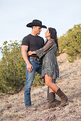 cowboy with a beautiful girl outdoors in The West