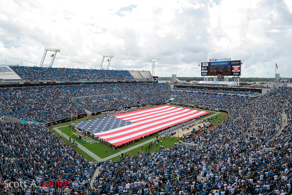 A large US flag covers the field prior to the NFL game between the Houston Texans and the Jacksonville Jaguars, at EverBank Field on September 16, 2012 in Jacksonville, Florida. ©2012 Scott A. Miller.