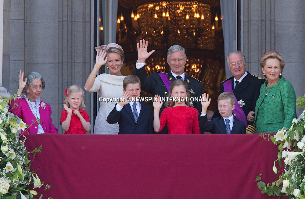 KING PHILIPPE AND QUEEN MATHILDE AND FAMILY<br /> The new Belgian King Philippe,53, and Queen Mathilde,40, wave to the crowds from the balcony of the Royal Palace, Brussels_21/07/2013<br /> During an emotional ceremony in the Royal Palace, Albert,79, signed a formal act of abdication before his son Prince Philippe,53, was sworn in as King Philippe of the Belgians in all three of the divided country's federal languages of Dutch, French and German.<br /> Albert has abdicated in favour of his son just three weeks before his 20th anniversary on the throne, after taking over from his brother King Baudouin of Belgium who died on 31 July 1993. He is known to be exhausted after a difficult five years where deep divisions between squabbling Flemish and Walloons political parties have pushed the country to the brink of break-up.<br /> Mandatory Credit Photos:&copy;NEWSPIX INTERNATIONAL<br /> <br /> **ALL FEES PAYABLE TO: &quot;NEWSPIX INTERNATIONAL&quot;**<br /> <br /> PHOTO CREDIT MANDATORY!!: NEWSPIX INTERNATIONAL(Failure to credit will incur a surcharge of 100% of reproduction fees)<br /> <br /> IMMEDIATE CONFIRMATION OF USAGE REQUIRED:<br /> Newspix International, 31 Chinnery Hill, Bishop's Stortford, ENGLAND CM23 3PS<br /> Tel:+441279 324672  ; Fax: +441279656877<br /> Mobile:  0777568 1153<br /> e-mail: info@newspixinternational.co.uk
