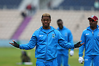 Cricket - 2019 ICC Cricket World Cup - Group Stage: South Africa vs. West Indies<br /> <br /> Shimron Hetmyer of the West Indies seems unsure of how much play will happen today as it starts to rain at the Hampshire Bowl Southampton England<br /> <br /> COLORSPORT/SHAUN BOGGUST