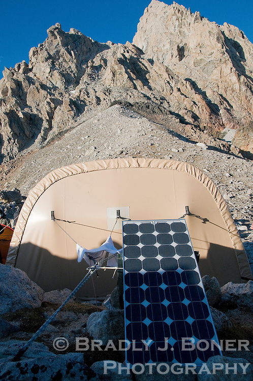 NEWS&GUIDE PHOTO / BRADLY J. BONER.Exum Mountain Guides has taken measures to limit their impact at the Lower Saddle of the Grand Teton, including installing a solar panel for electricity behind the hut used to house climbing clients.
