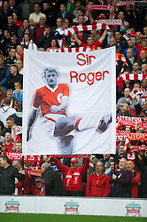 LIVERPOOL, ENGLAND - Saturday, October 20, 2012: Liverpool supporters on the Spion Kop with a 'Sir Roger Hunt' banner during the Premiership match against Reading at Anfield. (Pic by David Rawcliffe/Propaganda)
