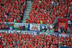 """LYON, FRANCE - Wednesday, July 6, 2016: Wales supporters with a banner """"Heros for one day"""" """"Ammanford AFC"""" """"Merthyr Town"""" in action against Portugal during the UEFA Euro 2016 Championship Semi-Final match at the Stade de Lyon. (Pic by Paul Greenwood/Propaganda)"""