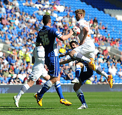 Bolton Wanderers' Tim Ream competes with Cardiff City's Peter Whittingham and Sean Morrison - Photo mandatory by-line: Paul Knight/JMP - Mobile: 07966 386802 - 06/04/2015 - SPORT - Football - Cardiff - Cardiff City Stadium - Cardiff City v Bolton Wanderers - Sky Bet Championship