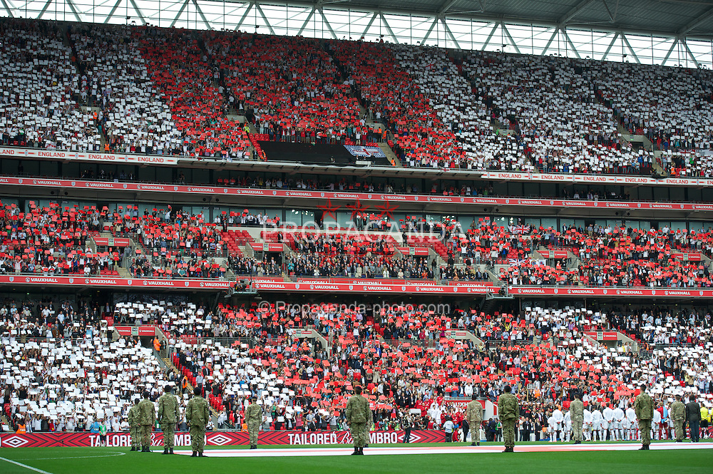 LONDON, ENGLAND - Saturday, June 2, 2012: England supporters make a St. Geroge's Cross mosaic before the International Friendly match against Belgium at Wembley. (Pic by David Rawcliffe/Propaganda)