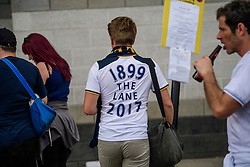 "© Licensed to London News Pictures. 14/05/2017. London, UK. A supporter wearing a shirt reading ""1899 THE LANE 2017"" enters White Heart Lane, in North London where Tottenham Hotspur F.C. are playing their final game at the ground, against Manchester united today (Sun). Known as 'The Lane', Tottenham have been playing at the ground for 118 years, but will be playing at Wembley next season while a new 60,000 seat stadium is built for the start of the 2018/19 season.  Photo credit: Ben Cawthra/LNP"