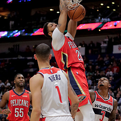 Nov 28, 2018; New Orleans, LA, USA; New Orleans Pelicans forward Anthony Davis (23) dunks against the Washington Wizards guard Bradley Beal (3) and guard Austin Rivers (1) during the fourth quarter at the Smoothie King Center. Mandatory Credit: Derick E. Hingle-USA TODAY Sports