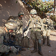 Soldiers from B Coy 3 Scots prepare to leave a compound during Operations Tora Pishaw aimed at disrupting insurgent activity in their AO (Area of Operations.  Minutes later as they searched a nearby compound an IED exploded severely wounding Pte Stephen Bainbridge (far right) who lost both legs as a result of the blast. Loya Manda, Nad e Ali North, Helmand Province, Afghanistan on the 11th of November 2011.