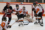 2012/03/04 - RIT's Lindsay Grigg blocks a shot in the second period of the ECAC West Championship game between RIT and SUNY Plattsburgh at RIT's Ritter Arena on March 4th, 2012. RIT lead 2-1 after two periods of play.