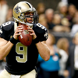 Oct 27, 2013; New Orleans, LA, USA; New Orleans Saints quarterback Drew Brees (9) against the Buffalo Bills prior to a game at Mercedes-Benz Superdome. Mandatory Credit: Derick E. Hingle-USA TODAY Sports
