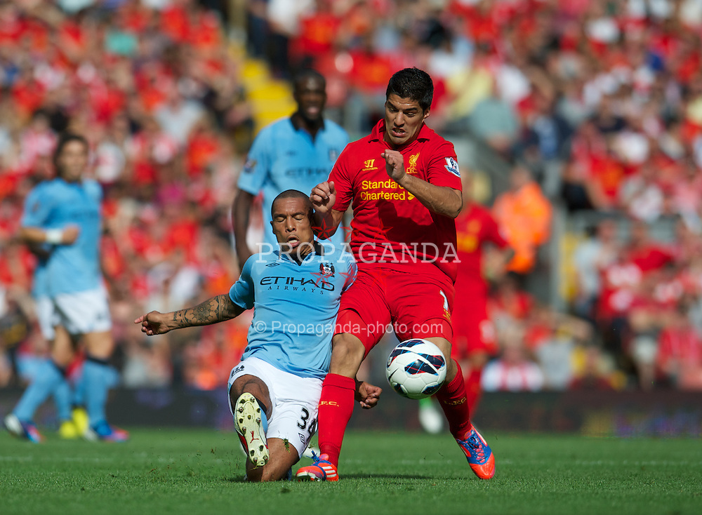 LIVERPOOL, ENGLAND - Sunday, August 26, 2012: Liverpool's Luis Alberto Suarez Diaz in action against Manchester City's Nigel de Jong during the Premiership match at Anfield. (Pic by David Rawcliffe/Propaganda)
