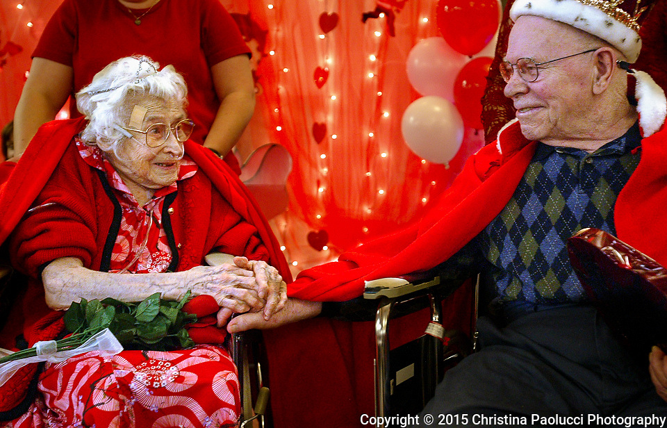 Don Fiegel reaches out for Cecile Kautz's hand after they were named king and queen of the Valentine Dinner and Dance at Fairview Care Center in Dodge Center Tuesday evening.  Many family and friends came out for the event. Fiegel from Kasson and Kautz from Mantorville are residents of the Fairview Care Center.  (Rochester Post-Bulletin, Christina Paolucci)