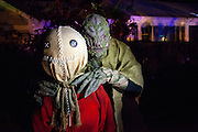 "Chris Baker is photographed with ""Sam"" from the cult classic movie ""Trick 'r Treat"" in his haunted yard in South Yarmouth, MA. Every year Baker sets up an elaborate Halloween display in his yard and on Halloween, neighborohood residents walk through his frightening ""vortex"" of horror while trick or treating."